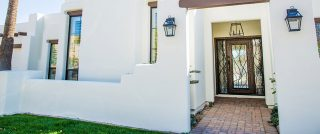 Iron Entry Door with Sidelights in Adobe style house