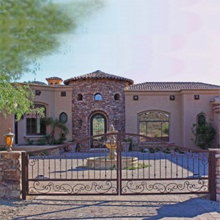 Beautiful Curb Appeal with Iron Doors and Gates